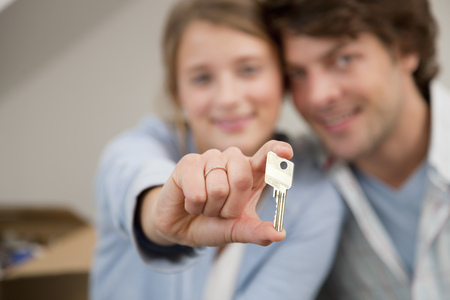Woman holding key to new home
