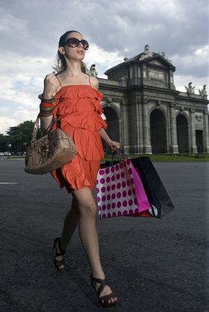 Woman with shopping at Puerta de Alcala