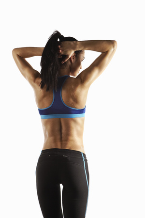 Athlete stretching arms and back