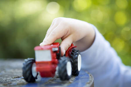 Close up of toddlers hand with toy LANG_EVOIMAGES