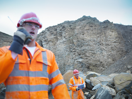 Workers walking in stone quarry LANG_EVOIMAGES