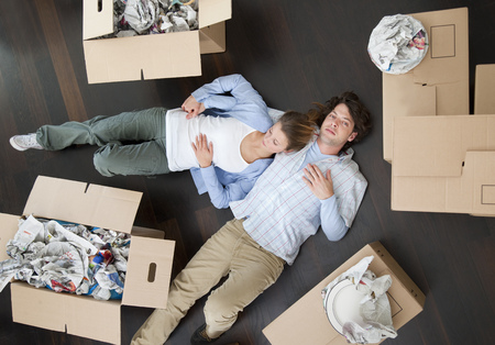 accomplishes: Couple laying together on floor