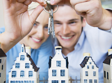 new age: Couple with keys and model houses