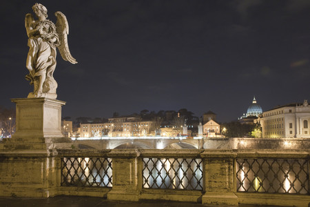 histories: Bridge and statues lit up at night