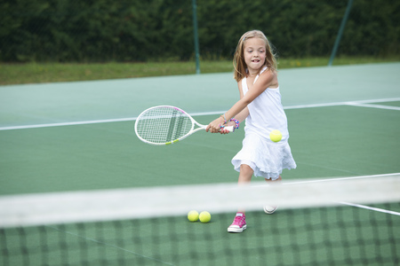 hits: Girl playing tennis on court