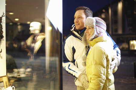 requires: Couple window shopping together