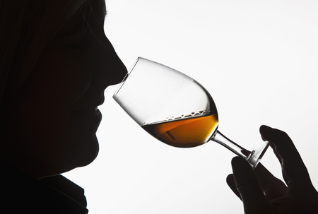 assessed: Worker smelling whisky in distillery