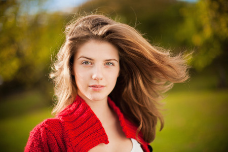 Teenage girl's hair blowing in wind LANG_EVOIMAGES
