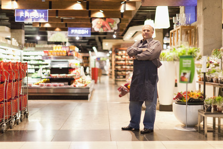 store shelf: Clerk standing in grocery store