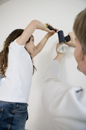 poppa: Father and daughter fixing light fixture