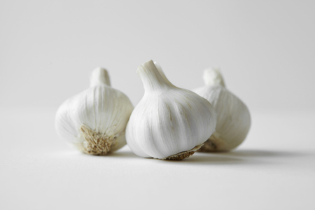 uncomplicated: Close up of heads of garlic
