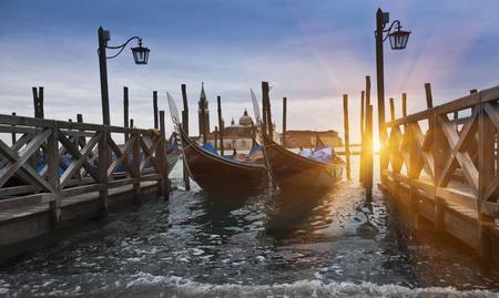 Gondolas docked on urban pier