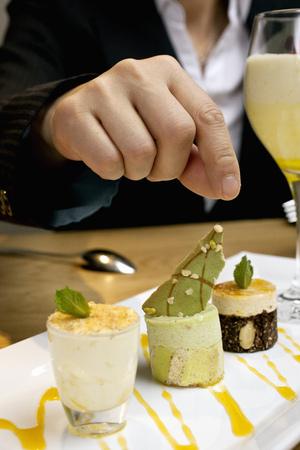 womens hands: Businesswoman reaching for dessert