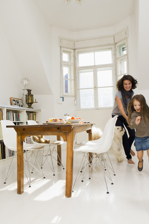 whimsy: Woman playing with daughter in kitchen