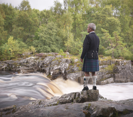 prideful: Time lapse view of man in kilt by river LANG_EVOIMAGES