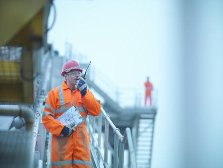 Construction worker using walkie talkie