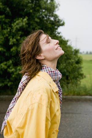 saturating: Smiling woman walking on rural road