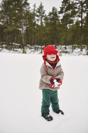 Boy playing in snow outdoors
