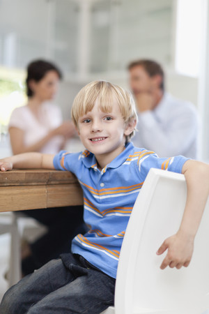 seating area: Smiling boy sitting at table LANG_EVOIMAGES