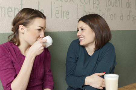 feasting: Women having cup of coffee in cafe LANG_EVOIMAGES