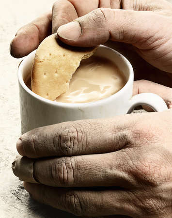 dirtied: Close up of dirty hands having tea LANG_EVOIMAGES
