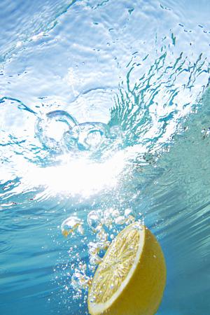 Lemon floating in swimming pool