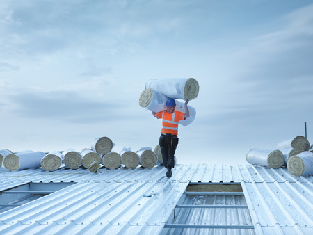 replaces: Worker carrying insulation on roof