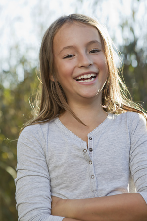 spirited: Smiling girl standing outdoors