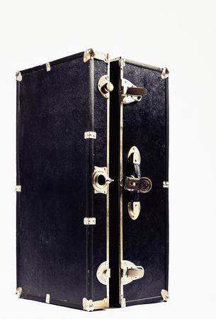 outmoded: Close up of black and gold trunk