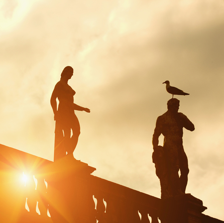 Silhouette of statues against cloudy sky LANG_EVOIMAGES