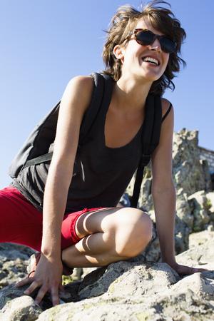 cease: Hiker resting on rocks