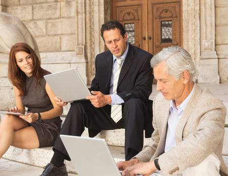 telecommuter: Business people working on stone steps LANG_EVOIMAGES