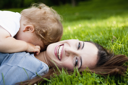 bashfulness: Mother holding toddler in park