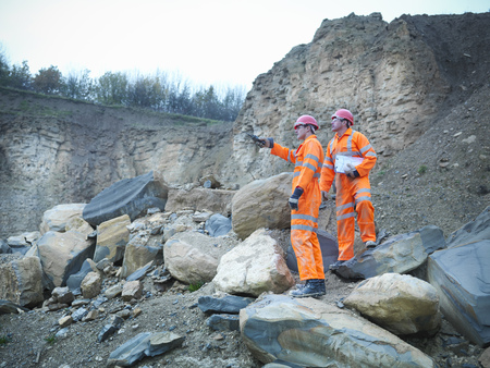 assessed: Workers examining rocks in quarry