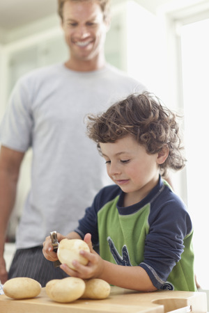 poppa: Boy peeling potatoes in kitchen
