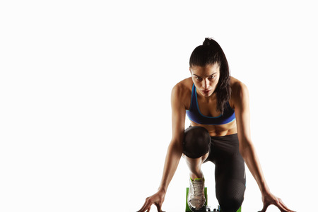 knelt: Athlete crouched at starting block