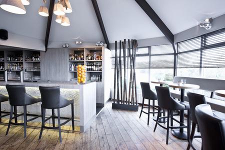 lavishly: Bar and tables in modern restaurant