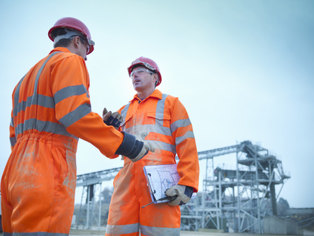 assessed: Workers talking at quarry