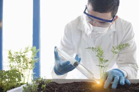 additional chemicals: Scientist planting with glowing liquid