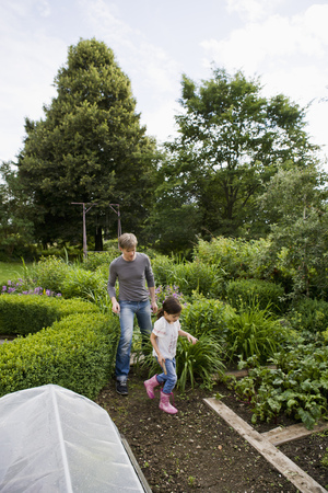 pursued: Father and daughter gardening together LANG_EVOIMAGES