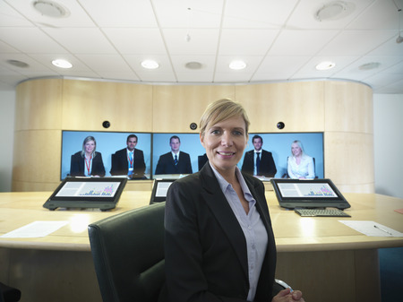 prideful: Business people having video conference LANG_EVOIMAGES