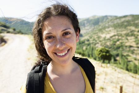 Woman smiling on hill