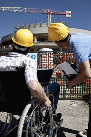 Man in wheelchair at construction site LANG_EVOIMAGES
