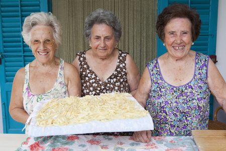 Older women with basket of pasta