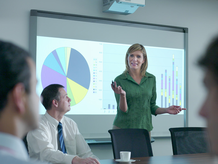 interrogations: Businesswoman with projection in meeting