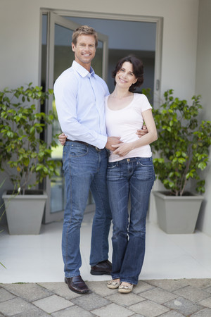 Couple smiling outside front door