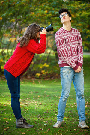 Teenage girl taking picture of boyfriend