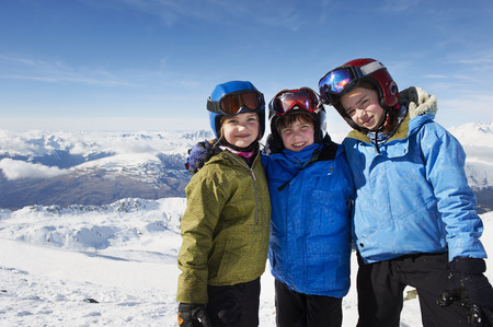 mountainous: Children standing together in snow