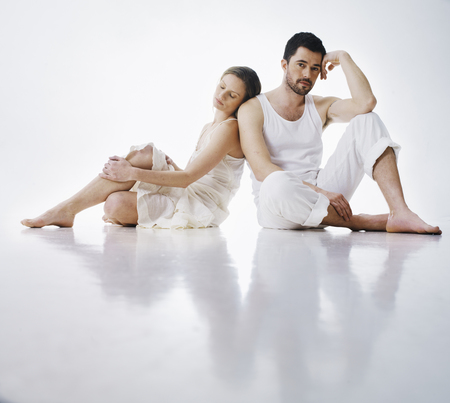 Couple sitting together on floor LANG_EVOIMAGES