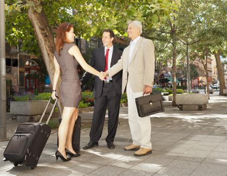 sidewalk talk: Business people shaking hands outdoors